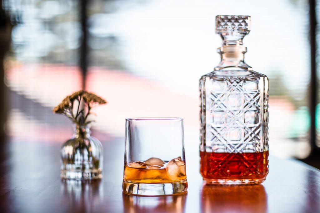 Bottle of rum, glass of rum